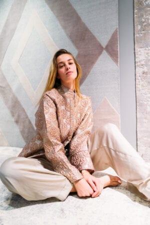Model Deborah Ghys wearing Diana d'Orville luxury brocade jacket in pale pink cream & metallic gold