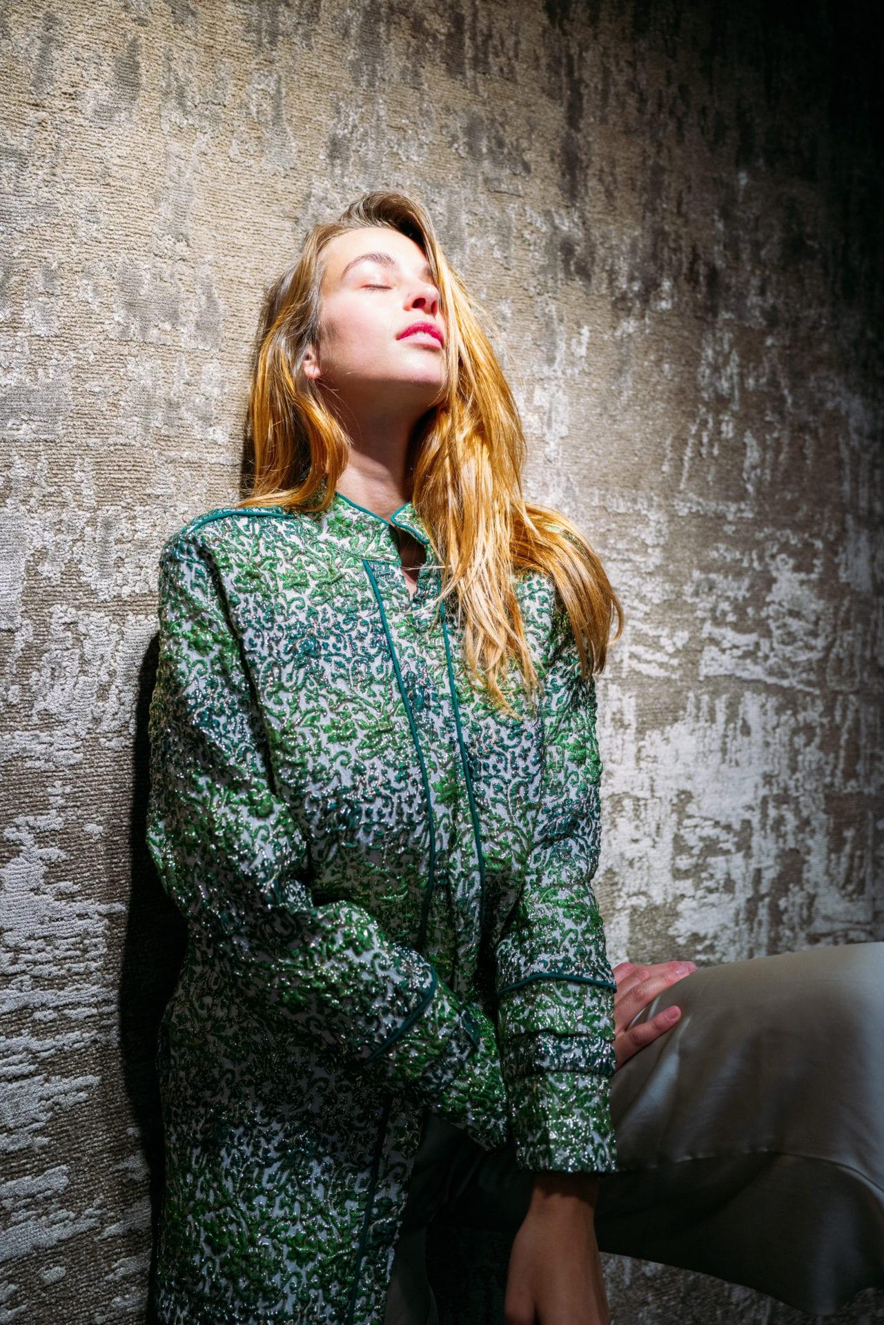 Model Deborah Ghys wearing Diana d'Orville luxury brocade jacket in emerald, cream & metallic gold