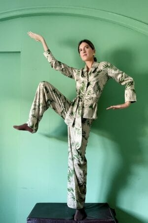 Ynes Ibarra in Diana d'Orville Sustainable Luxury palazzo set with green palm leaves prints on cream background