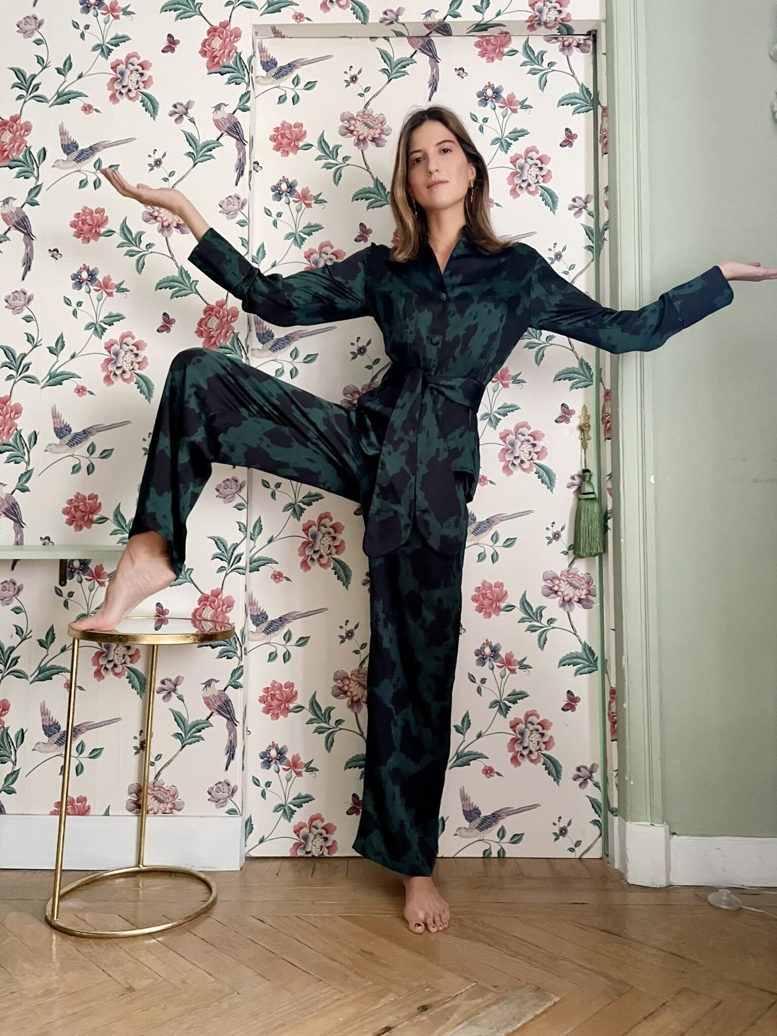 Ynes Ibarra wearing silk luxury loungewear pyjama in navy and peacock tones