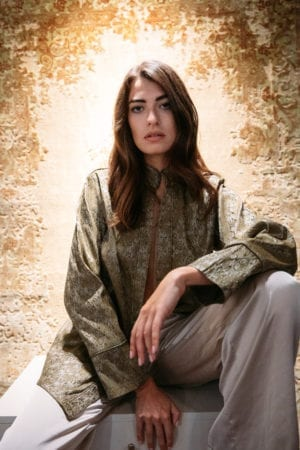 Model wearing Diana d'Orville emerald & silver brocade jacket