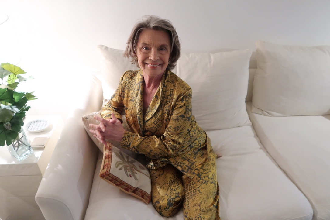Diana d'Orville grandmother model wearing sustainable luxury loungewear - green and gold silk pigiama palazzos
