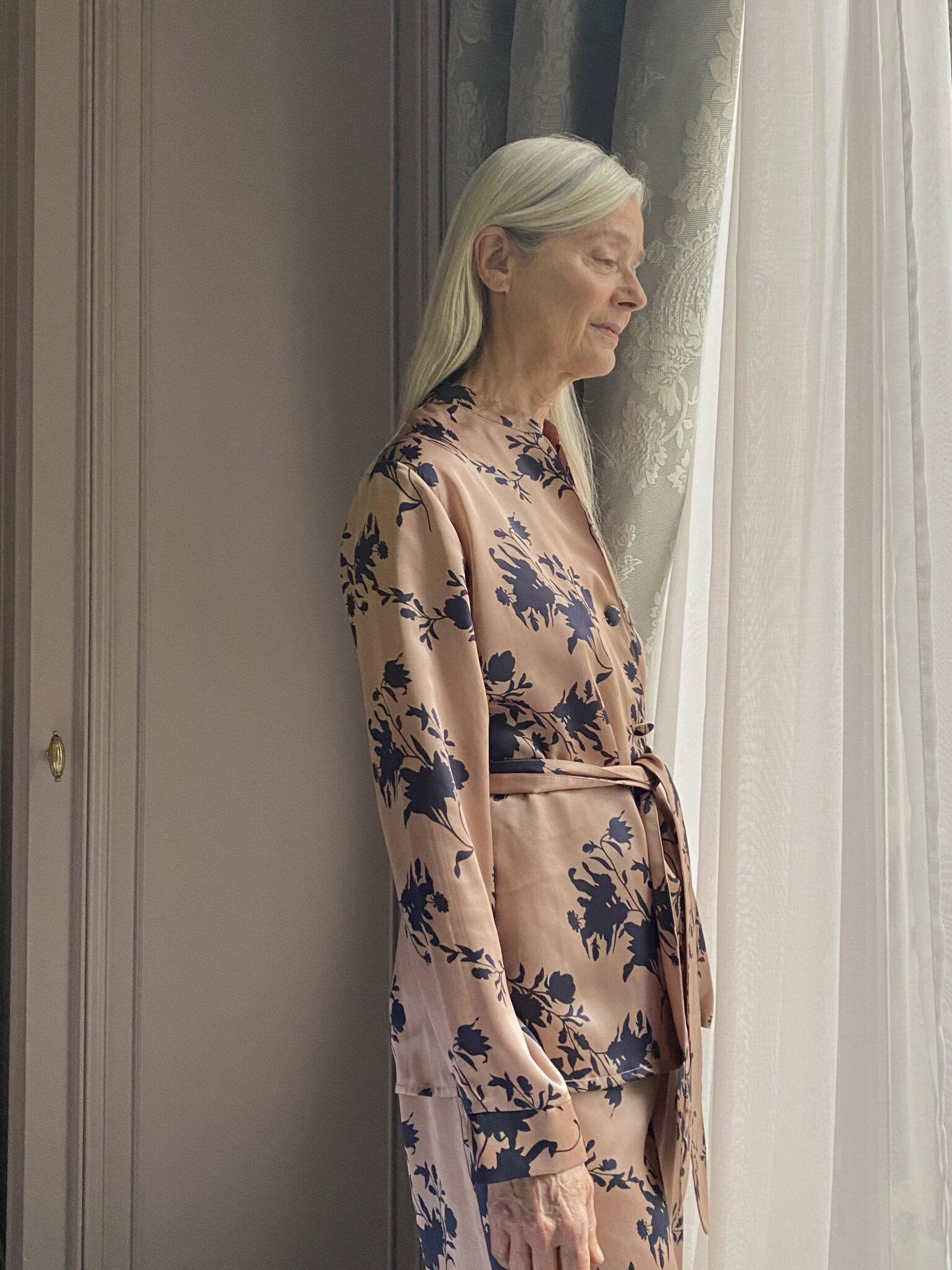 Axelle Doue in Diana d'Orville luxury silk suit roses prints