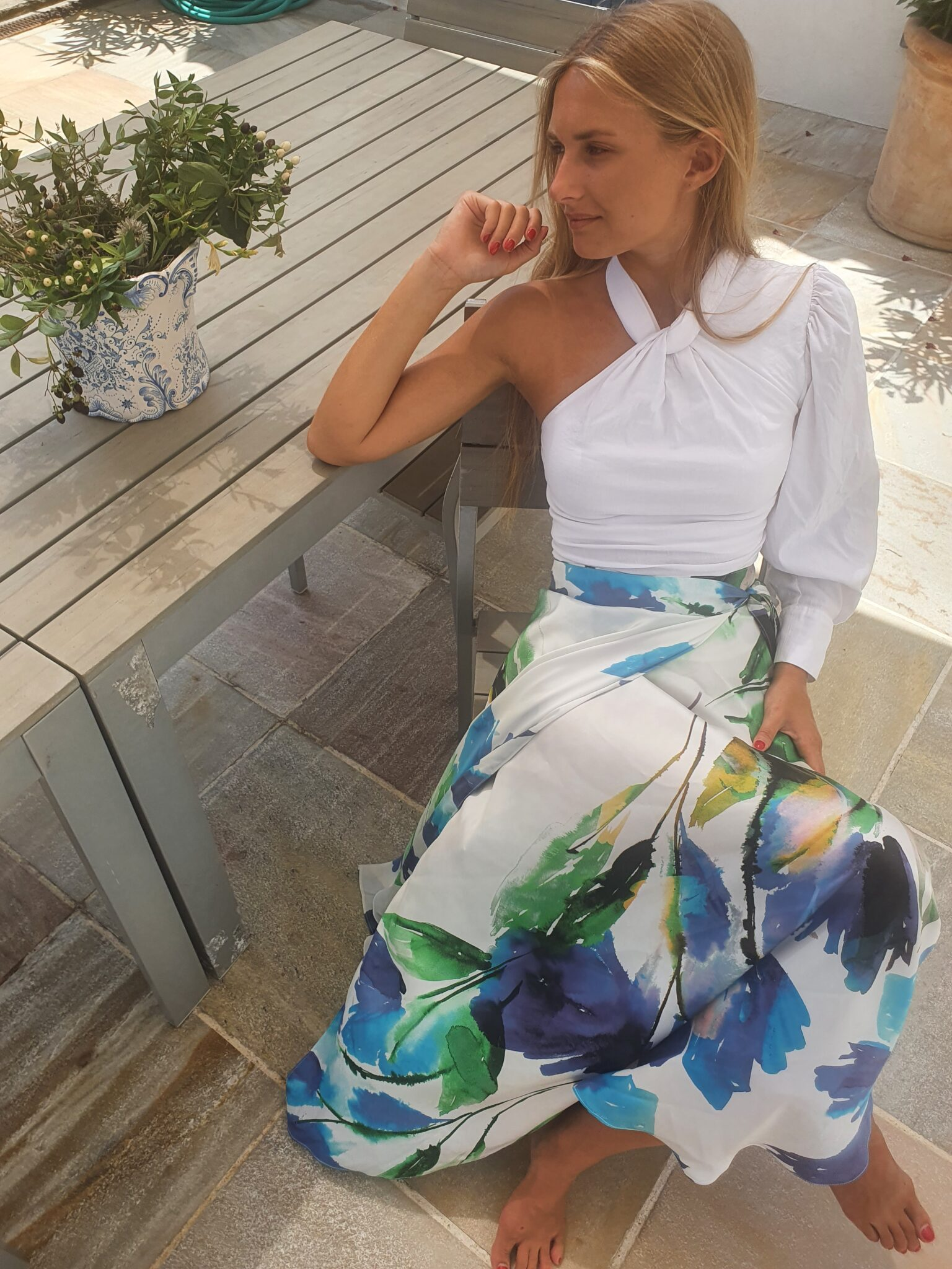Diana d'Orville printed silk skirt with blue flowers on white background