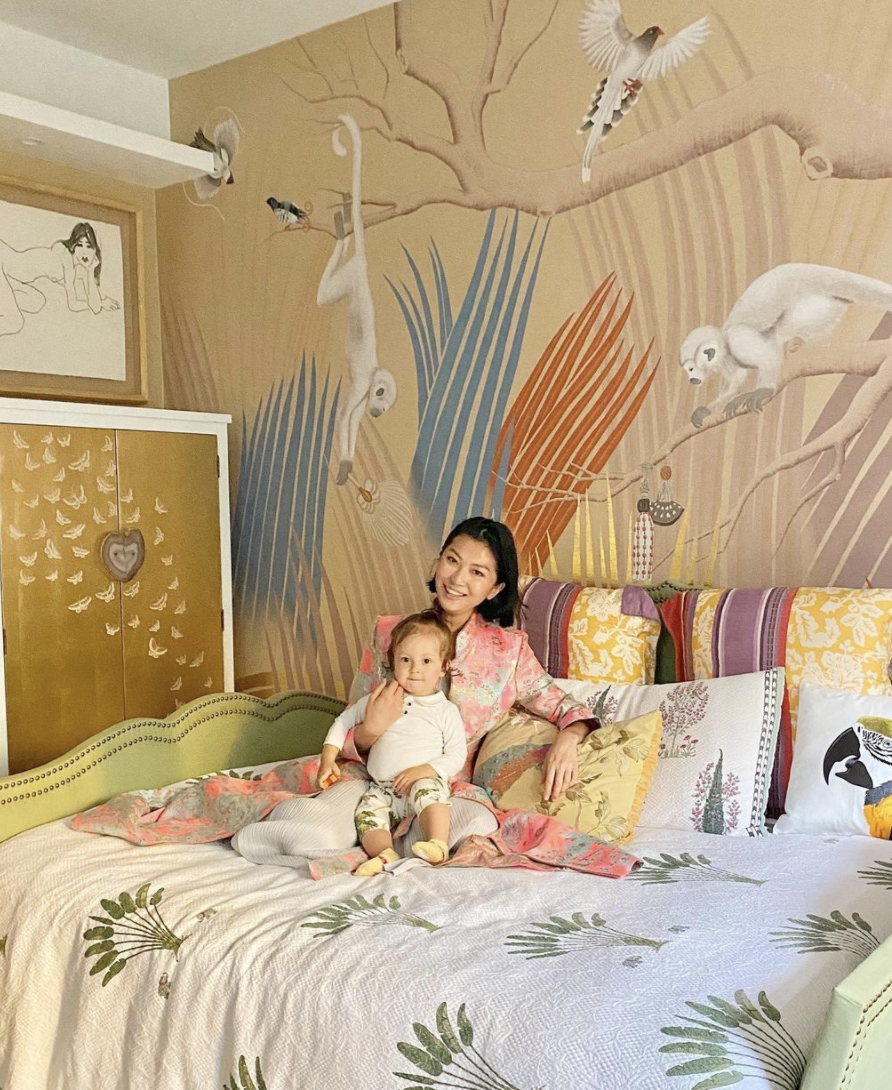 Laura Cheung from Lala Curio wearing Diana d'Orville pink brocade sustainable luxury gown with her son for Tatler Asia